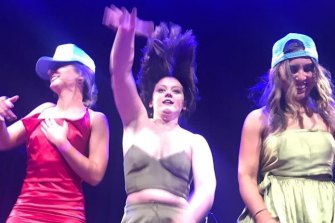 Bridgette, Caroline and Julia Joyce, daughters of Barnaby Joyce, on stage at the White Elephant Ball in Tamworth last weekend.