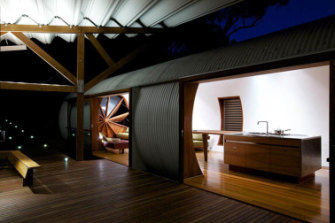 The living and sleeping pods at the Drewhouse are separated for privacy but connected by a wooden covered walkway.