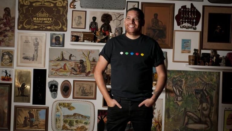 Artist Tony Albert in front of his exhibition at the Queensland Art Gallery.
