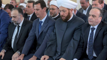 Syrian President Bashar al-Assad, second from left, prays on the first day of Eid al-Adha at al-Rawda mosque, in Damascus, Syria, last week.