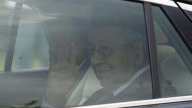 Prime Minister Mahathir Mohamad leaves after meeting with King Sultan Abdullah Sultan Ahmad Shah at the National Palace in Kuala Lumpur, Malaysia, Monday, Feb. 24, 2020. Mahathir, 94, tendered his resignation to Malaysia's king while his political party quit the ruling alliance in a shocking political upheaval less than two years after his election victory. (AP Photo)