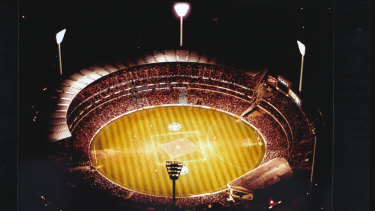 Floodlights illuminate the MCG as more than 79,000 spectators take their seats for the first night final.