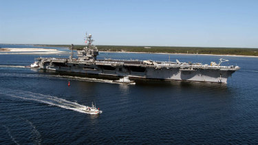 This Navy handout photo shows the USS John F. Kennedy arriving at Naval Air Station Pensacola in 2004.