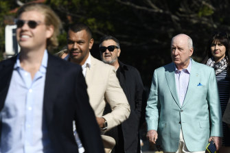 Alan Jones boarding a yacht at Rose Bay Wharf, with Wallaby Kurtley Beale ahead of him on Friday.