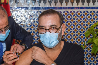 Morocco's King Mohammed VI receives the COVID-19 vaccine at the Royal Palace in Fez.
