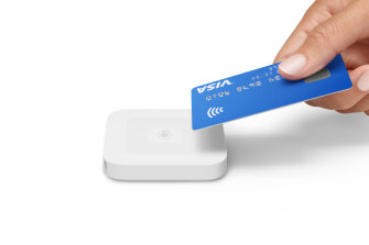 """A Square """"tap and go"""" card reader."""