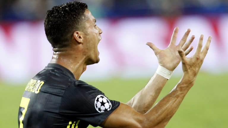 Stunned: Cristiano Ronaldo reacts after being shown a straight red card.
