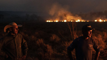 The battle against fire in the state of Mato Grosso, Brazil, on Friday. Under increasing international pressure to contain the fires sweeping parts of the Amazon, President Jair Bolsonaro authorised the military to battle the massive blazes.