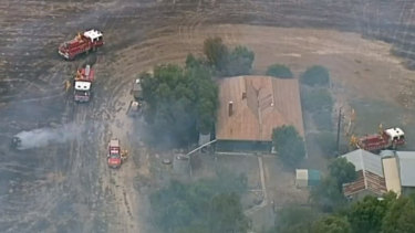 The ring of black grass around this saved home shows the fast work of CFA crews at Strathallan.