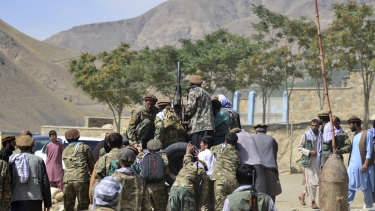 Militiamen loyal to Ahmad Massoud, son of the late Ahmad Shah Massoud, push a vehicle during a training exercise, in Panjshir province.