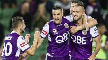 Perth Glory players celebrate the lone goal against Newcastle that clinched the Premiers Plate.
