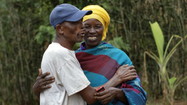 Genocide survivor Laurencia Mukalemera, a Tutsi, greets Tasian Nkundiye, a Hutu who murdered her husband and spent eight years in prison for the killing and other crimes, at Nkundiye's home in the reconciliation village of Mbyo, near Nyamata, in Rwanda.
