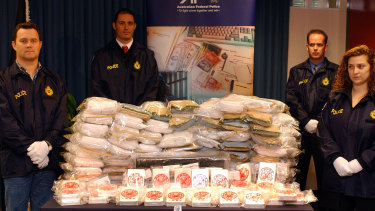 AFP officers display a heroin haul linked to the Pong Su.