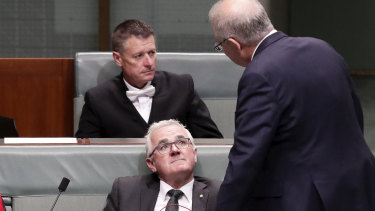 Crossbench MP Andrew Wilkie speaks with Prime Minister Scott Morrison after a division in the House of Representatives on December 6.