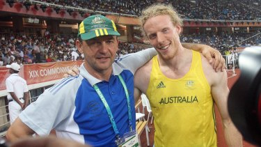 Alex Parnov (left) with Steve Hooker at the 2010 Commonwealth Games.