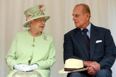 Queen Elizabeth talks with The Duke of Edinburgh as she waits to rededicate the rainforest walk, as she tours Southbank , in Brisbane, Queensland, in 2011.