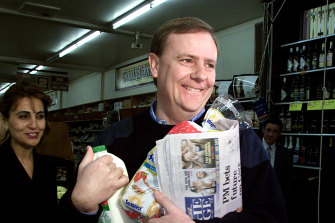 Peter Costello buys groceries on the first day of the GST on July 1, 2000. The GST marks the last far-reaching reform of the nation's tax system.