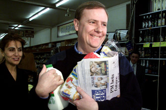 Peter Costello buys groceries on the first day of the GST on July 1, 2000.