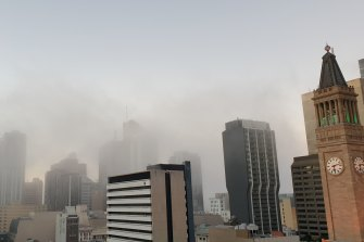 Heavy fog has hit Brisbane's CBD as temperatures are expected to drop.