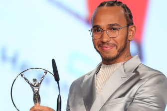 Laureus World Sportsman of the Year British F1 driver Lewis Hamilton poses with his award during the 2020 Laureus World Sports Awards .