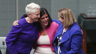 Crossbench MPs Kerryn Phelps, Julia Banks and Rebekha Sharkie celebrate after the bill passes the House of Representatives.