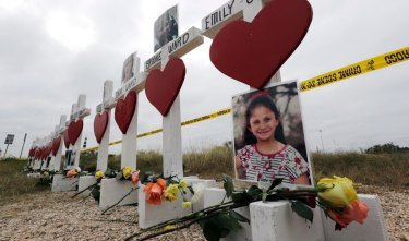 Crosses showing victims' names near the First Baptist Church in Sutherland Springs, Texas in November.
