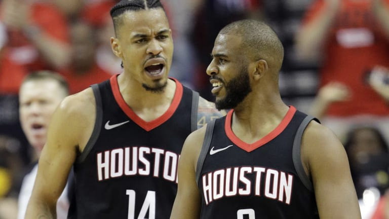 All square: Houston Rockets guard Chris Paul, right, celebrates with teammate Gerald Green.