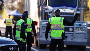Queensland Police stop trucks at the border in Coolangatta in August.