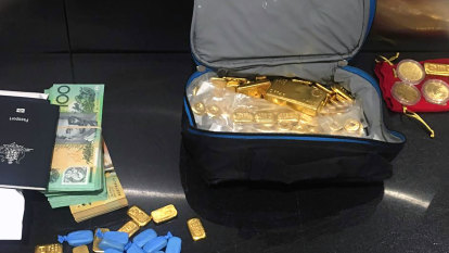 Gold bullion, luxury cars and cash seized in alleged $10 million NDIS scam
