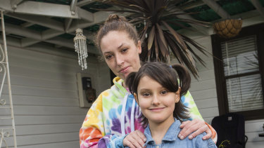 Krystal Baker with her daughter Stormii-lee, whose reading has been improved by a peer-to-peer reading program.