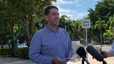 Treasurer Cameron Dick speaking at the Cairns Marina on Thursday, economic plan in hand.