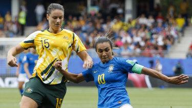 Australia's Emily Gielnik tussles with Brazilian legend Marta.