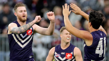 Slotted: Cam McCarthy (left) celebrates a goal for Fremantle.