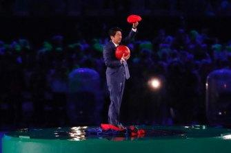 Super Shinzo: Japan's Prime Minister Shinzo Abe appeared dressed as Mario.