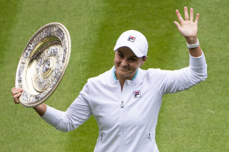 Ash Barty lifts the trophy after winning Wimbledon.