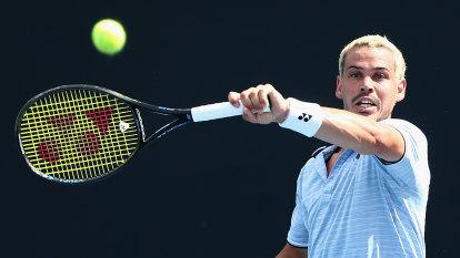 Emotional Bolt advances at Australian Open wildcard playoff