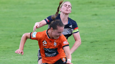 Eyes wide shut: Victory goalscorer Natasha Dowie clashes with Celeste Boureille of the Roar.