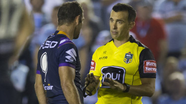 Taking control: Matt Cecchin lays down the law to Storm skipper Cameron Smith.