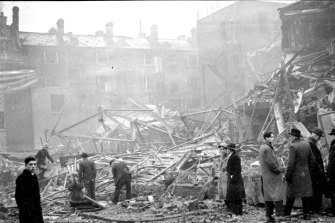 Rescue workers clear rubble after a London department store was hit by German bombs. Francis Spufford's novel begins with just such a raid cutting short the lives of his five main characters.