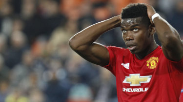 Manchester United's Paul Pogba reacts after missing a chance against Valencia.