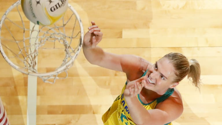 Faultless: Caitlin Bassett scores another goal during the Diamonds' Constellation Cup victory over New Zealand at the Townsville Entertainment Centre.