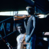 Bougainville Revolutionary Army guerillas stand next to a destroyed dump truck inside the captured Panguna mine in 1994.