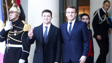 French President Emmanuel Macron, right, greets Ukrainian President Volodymyr Zelenskiy before the talks at the Elysee Palace on Monday.
