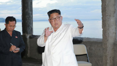 North Korean leader Kim Jong-un gestures during a visit to the construction site of a hotel in North Korea. State media say that Kim has harshly reprimanded local officials over a delayed construction project.