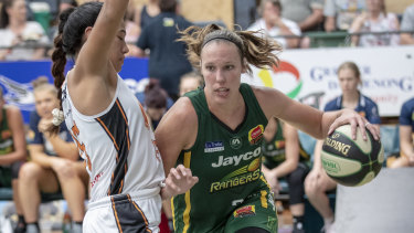 baseline drive: Ranger Kayla Pederson finds her way around rising Townsville star Zitina Aokuso.