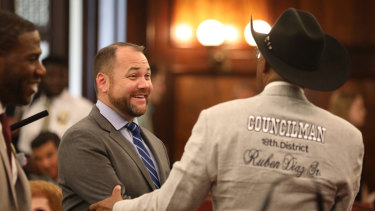 Corey Johnson, left, the speaker of the New York City Council, shakes hands with Councilman Ruben Diaz after the council voted to cap Uber and other ride-hail vehicles last month.