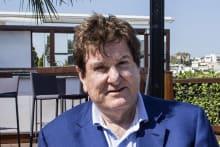 Billionaire Con Makris tips property upswing