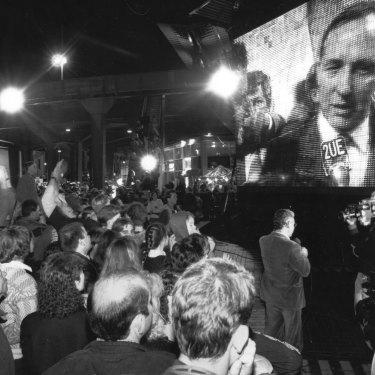 Prime Minister Paul Keating is on the big screen as Sydneysiders celebrate at Circular Quay.