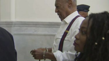 Bill Cosby is led away in handcuffs after he was sentenced.