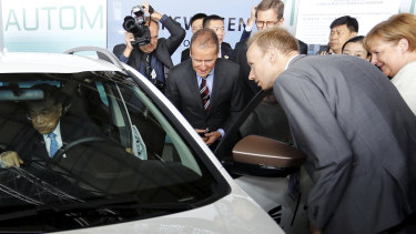 Chinese Premier Li Keqiang sits in a car as he and German Chancellor Angela Merkel and Herbert Diess, Volkswagen's CEO, attend a presentation for autonomous driving at Tempelhof airport in Berlin in 2018.